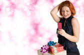 Happy smiling red-haired woman with boxes gifts and phone — Stock Photo