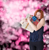 Happy smiling red-haired woman with holidays boxes gifts — Foto Stock