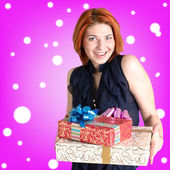 Happy smiling red-haired woman with holidays boxes gifts — Stock Photo