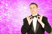 The elegant men in celebrations tuxedo on a abstract snow festive background — Stock Photo