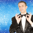 Elegant men in celebrations tuxedo on abstract snow background — Stock Photo #37445121