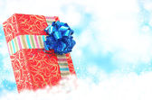 Christmas Surprise.Red Box Gift on the snow background. — Stockfoto