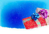 Surprise in New Year Holiday.Christmas.Gift boxes on a snow — Stock Photo