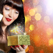 Festive box with a surprise for a charming Girl.Holiday concept — Stock Photo