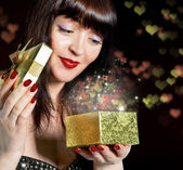 Valentines Day.Gift box with a surprise for a charming Girl — Stock Photo