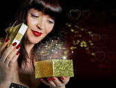Gift box with a surprise for a charming Woman.Valentines Day — Stock Photo