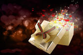 Gift golden box on a abstract background.Valentine Day.Holiday card — Stock Photo