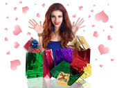 Beautiful happy girl rejoices gifts for Valentine's Day.Holiday concept — Stock Photo