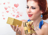 Beautiful happy girl rejoices gift for Valentine's Day.Holiday — Stock Photo