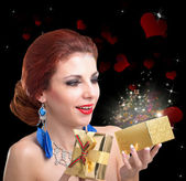 Valentine Day.Beautiful Happy Girl with Golden open Gift Box — Stock Photo