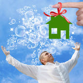 Happy Businessman in Dreams of a new Home — Stock Photo