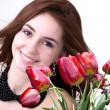 Beauty Woman brunette with Spring Flower bouquet tulips — Stock Photo