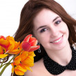 Stock Photo: Beauty Wombrunette with Spring Flower bouquet tulips
