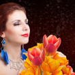 Stock Photo: Beauty Womwith Spring Flower