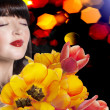 Stock Photo: Beauty Womwith Spring Flower bouquet