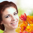 Stock Photo: Beauty Womwith Flower bouquet.Spring.Holiday