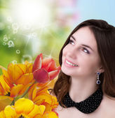 Beauty Woman with Flower bouquet.Spring — Stock Photo