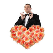 Man in Classical Black Tuxedo with Heart Flower Roses.Love concept.Beautiful Abstract Bouquet Roses.Wedding — Stock Photo