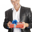 The happy smiling man with a celebratory gift — Stock Photo #6642047