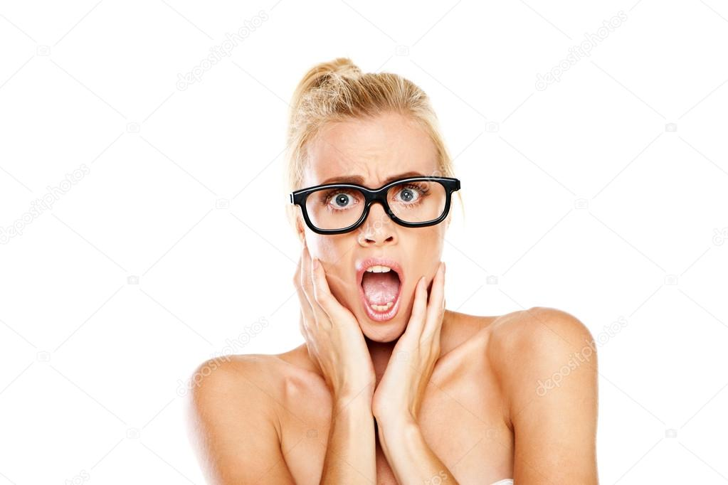 Woman wearing extremely large black framed glasses gasping in shock and horror — Stock Photo #12662091