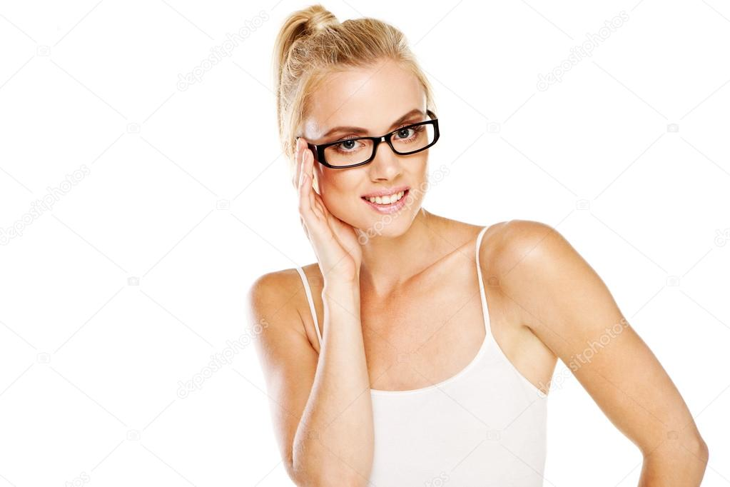 Smiling attractive intelligent woman wearing a pair of modern glasses with dark frames as a fashion accessory — Stock Photo #12684642