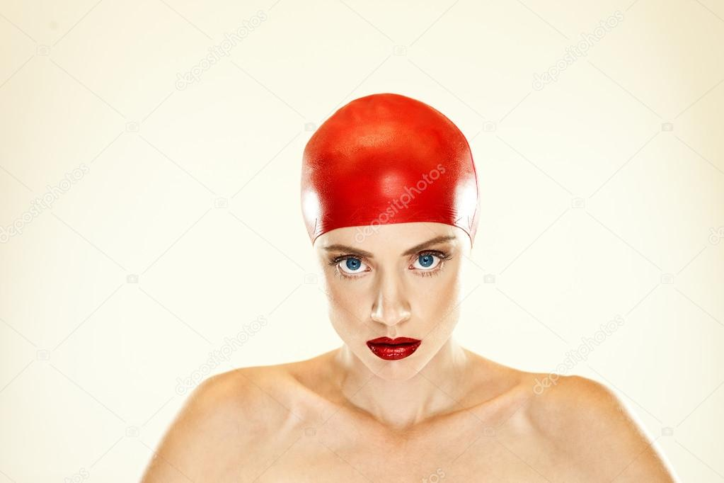 Woman in red swimming cap with matching red lipstick and beautiful large eyes — Stock Photo #12801607