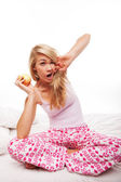 Woman with apple yawning — Stock Photo