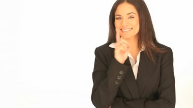 Laughing businesswoman pointing to the side — Stock Video