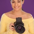 Smiling woman with vintage camera — Stock Photo