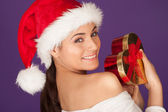Teasing woman with a Christmas gift — Stock Photo