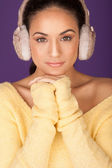 Stylish woman in winter ear muffs — Stock Photo