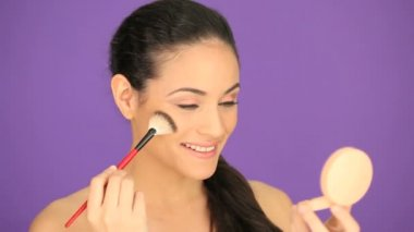 Beautiful woman applying foundation — Stock Video #13697883