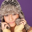 Pretty woman in fur trimmed winter hat — Stock Photo