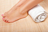 Womans feet with a rolled towel — Stock Photo