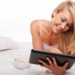 Blonde using tablet blonde using tablet — Stock Photo