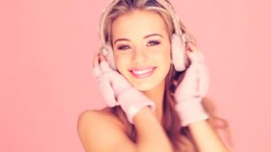 Laughing Girl In Mitts With Headphones — Stock Video
