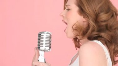 Singer Using A Microphone — Stock Video #13975344