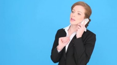 Businesswoman Talking Into Mobile Phone — Stock Video