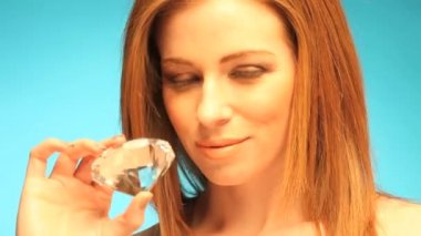 Beautiful Redhead Holding Gemstone — Stock Video #13978928