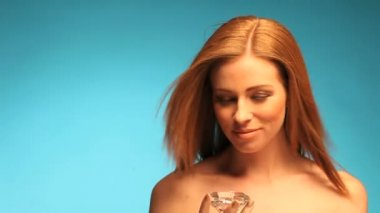 Topless Redhead woman over blue background — Stock Video