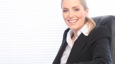 Businesswoman Seated In Office Chair — Stock Video #13984388