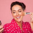 Laughing woman applying blusher — Foto de Stock