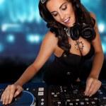Sexy curvy DJ mixing music — Stock Photo
