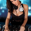 Beautiful busty DJ mixing sound — Stock Photo #14269555