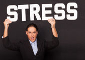 Businesswoman with the word STRESS — Stock Photo