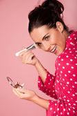 Beautiful woman applying foundation — Stock Photo