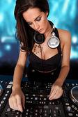 Beautiful busty DJ mixing sound — Stock Photo