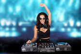 Jubilant sexy female disc jockey — Stock Photo
