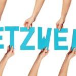 Turquoise alphabet lettering spelling NETZWERK — Stock Photo