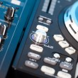 Closeup detail of a DJs deck with turntable - Stock Photo